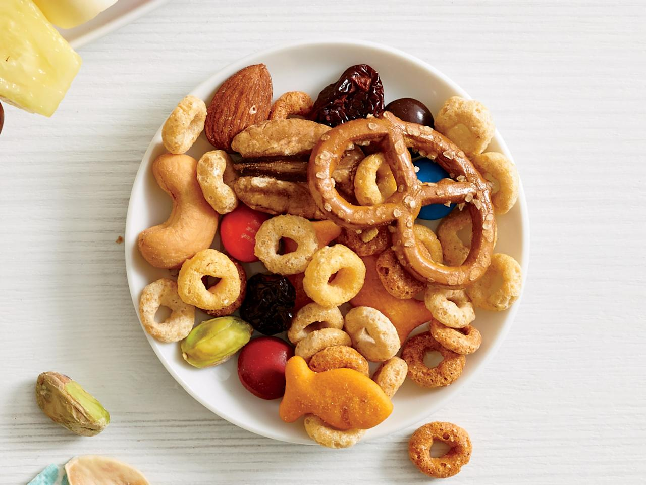 """<p>Nuts and Bolts Trail Mix satisfies a sweet and salty craving while giving you an energy boost throughout the day.</p> <p><a href=""""https://www.myrecipes.com/recipe/nuts-bolts-trail-mix"""">Nuts and Bolts Trail Mix Recipe</a></p>"""