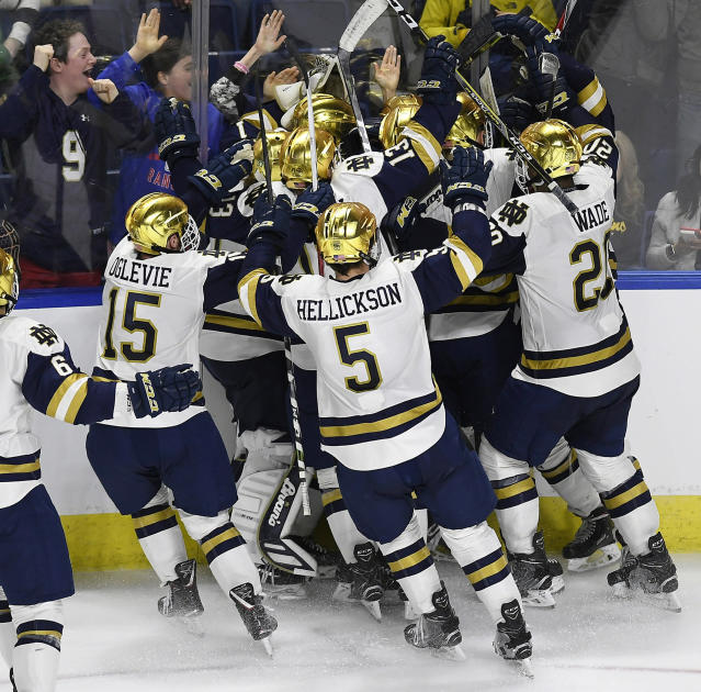 Notre Dame players celebrate their win in overtime of an NCAA college hockey regional tournament game against Michigan Tech, Friday, March 23, 2018, in Bridgeport, Conn. (AP Photo/Jessica Hill)