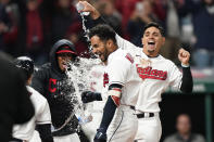 Cleveland Indians' Oscar Mercado, cdnter, is mobbed by teammates after hitting a two-run home run in the seventh inning in the second baseball game of a doubleheader against the Chicago White Sox, Thursday, Sept. 23, 2021, in Cleveland. (AP Photo/Tony Dejak)