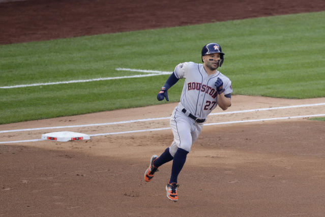 Houston Astros' Jose Altuve (27) rounds the bases after hitting a solo home run against the New York Yankees during the first inning of Game 3 of baseball's American League Championship Series, Tuesday, Oct. 15, 2019, in New York. (AP Photo/Seth Wenig)
