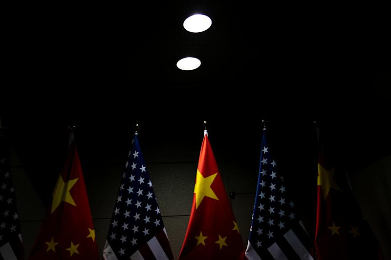 The flags of the U.S. and China are displayed as President Donald Trump and the Chinese leader, Xi Jinping, meet at the G20 Summit in Osaka, Japan, on June 29, 2019. (Erin Schaff/The New York Times)