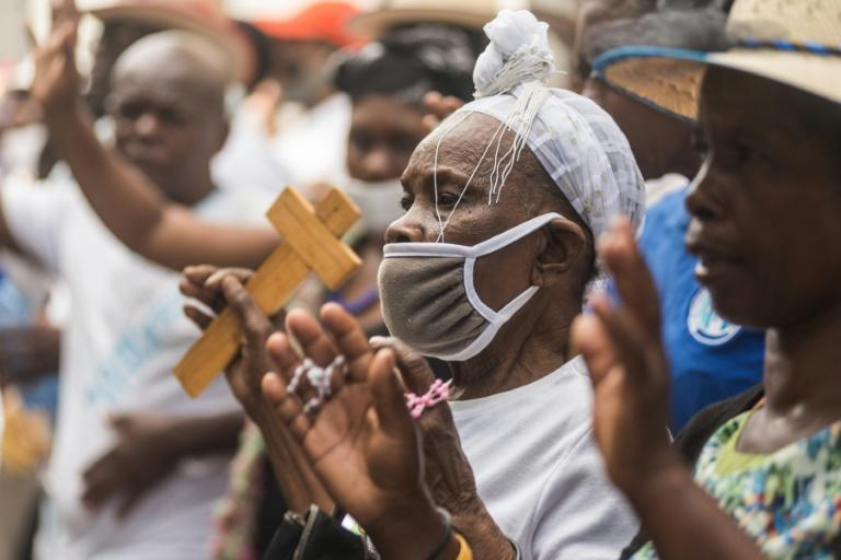 Catholic pilgrims pray ahead of Easter in Port-au-Prince, Haiti on April 2, 2021