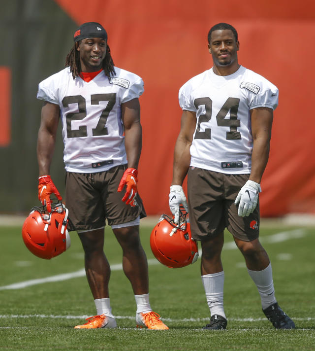 FILE - In this May 15, 2019, file photo, Cleveland Browns' Kareem Hunt (27) and Nick Chubb (24) talk during an NFL football organized team activity session at the team's training facility in Berea, Ohio. With Kareem Hunt returning from his eight-game NFL suspension to join Nick Chubb in Clevelands backfield, the Browns (3-6) have a dynamic duo that will test opposing defenses through the air and on the ground. In Sundays 19-16 win over Buffalo, the Hunt-Chubb tandem combined for 147 yards rushing and 49 receiving while helping the Browns snap a four-game losing streak that halted a season shaped by high expectations from dissolving into another mess. (AP Photo/Ron Schwane, File)