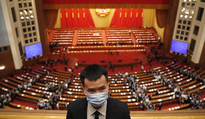 A security worker at the Great Hall of the People in Beijing. Photo: AP