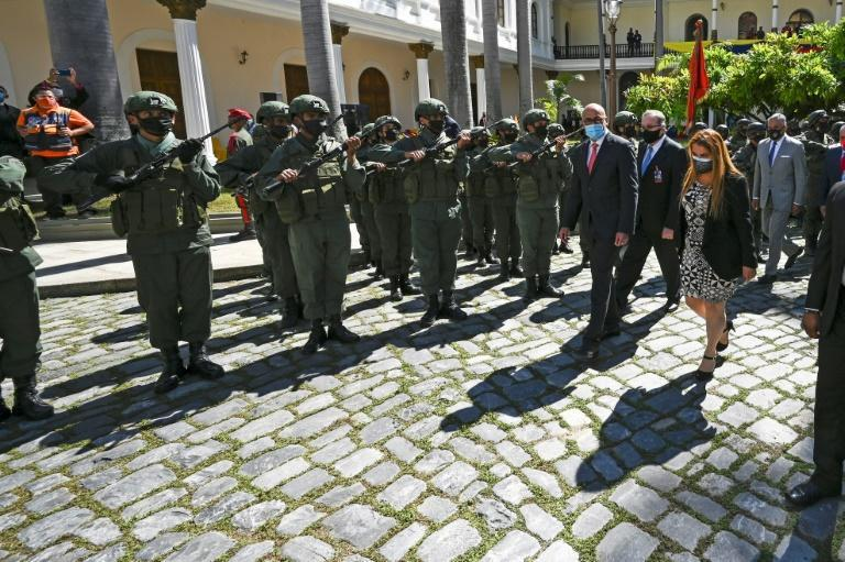 Lawmakers receive military honors after the swearing-in on January 5, 2021 of a new National Assembly in Venezuela, whose elections were criticized as unfair by the United States