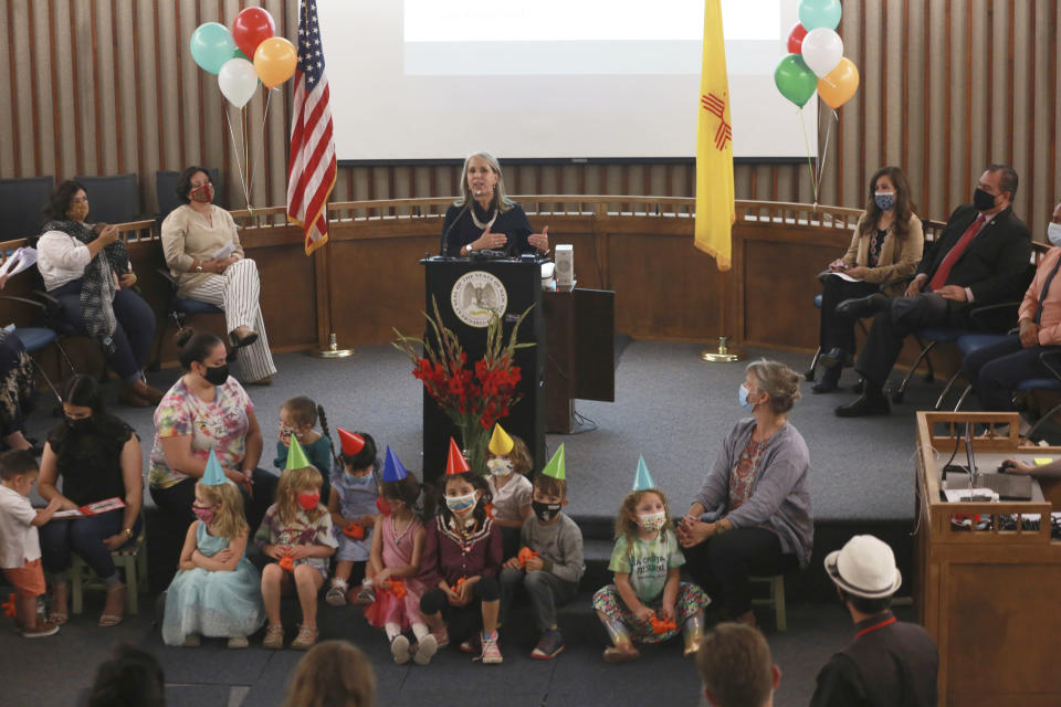 Gov. Michelle Lujan Grisham announces an increase in child care subsidies on Thursday, July 1, 2021, in Santa Fe, N.M. Subsidy eligibility expanded to families with income at 350% of the federal poverty line, the most generous in the nation. Lujan Grisham is calling for New Mexico to become the first U.S. state to offer universal child care. (AP Photo/Cedar Attanasio)
