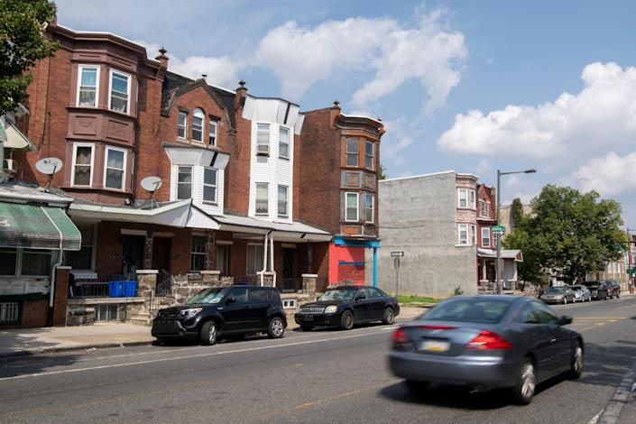 Cars pass by the home of Patricia Blair  in North Philadelphia.