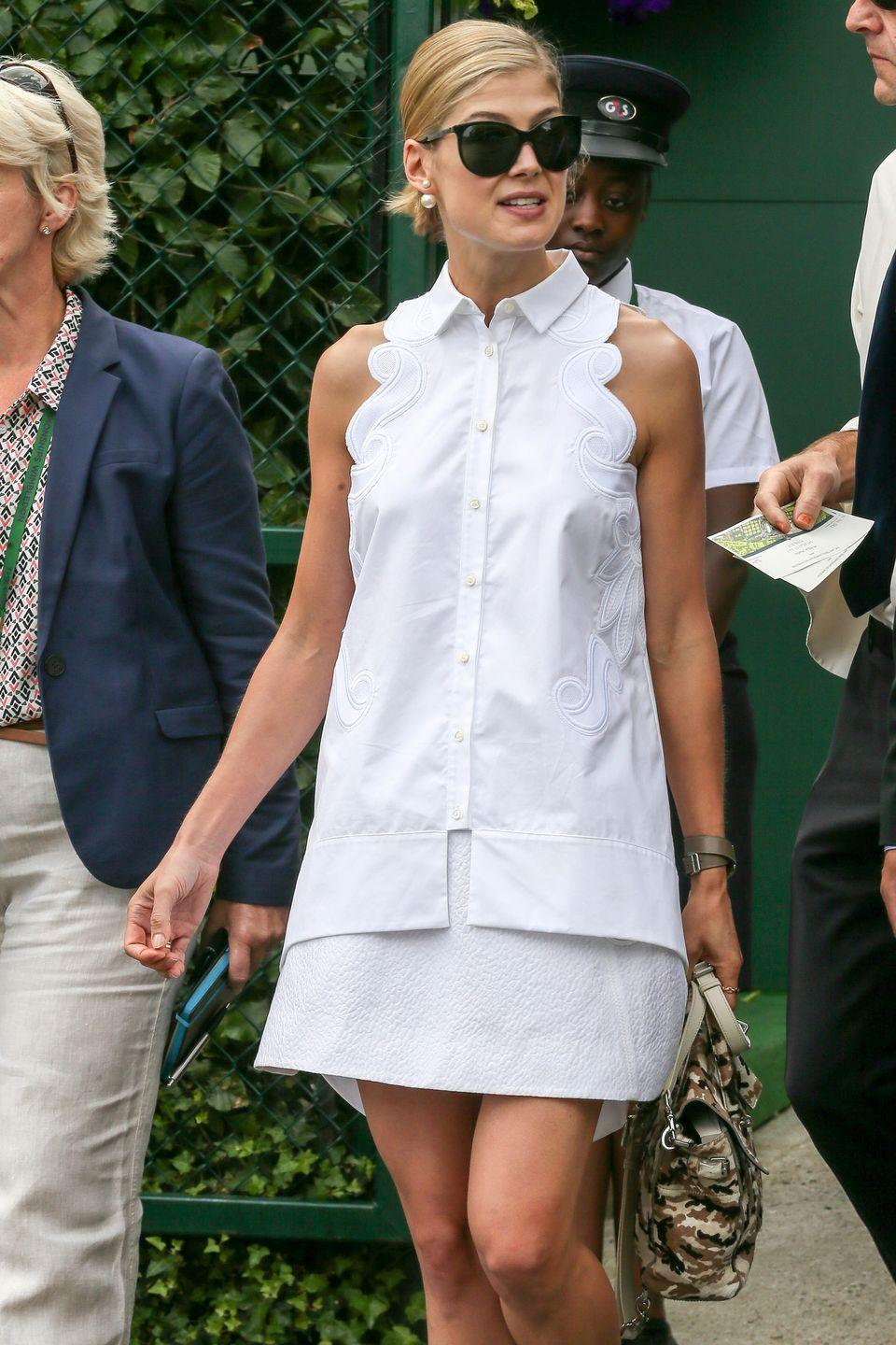 <p><strong>2015</strong> Rosamund Pike was pictured wearing a scalloped white shirt dress by Antonio Berardi.</p>