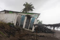 A home damaged by winds brought on by Hurricane Grace sits askew near the shore, in Tecolutla, Veracruz State, Mexico, Saturday, Aug. 21, 2021. Grace hit Mexico's Gulf shore as a major Category 3 storm before weakening on Saturday, drenching coastal and inland areas in its second landfall in the country in two days. (AP Photo/Felix Marquez)