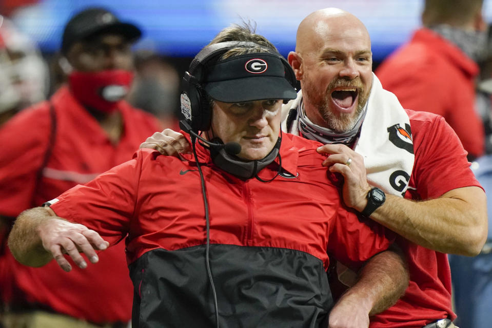 Georgia head coach Kirby Smart and another coach celebrate a Georgia field goal to beat Cincinnati during the second half of the Peach Bowl NCAA college football game, Friday, Jan. 1, 2021, in Atlanta. Georgia won 22-21. (AP Photo/Brynn Anderson)