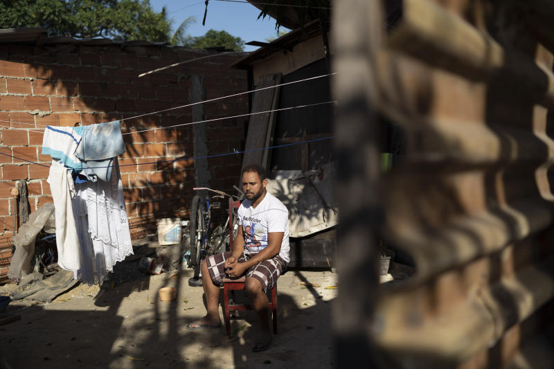 "In this June 20, 2019 photo, Jocely Rozario Junior, the father of Kaua, who was killed by a stray bullet, sits in his front yard at the Vila Alianca slum in Rio de Janeiro, Brazil. ""My son wasn't an adult or a trafficker. He wasn't anything like that, but he lived with fear every time he saw the police,"" Rozário Junior said. ""I can't be quiet because if so, Kaua would be just one more statistic."" (AP Photo/Leo Correa)"