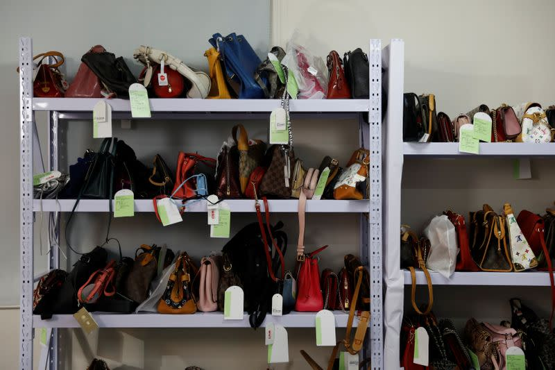 Handbags are seen on shelves during a livestreaming session for the second-hand luxury goods retail platform Plum in Beijing