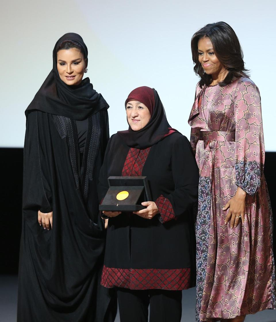 <p>In Doha, Qatar, the first lady spoke and handed out awards during the 2015 World Innovation Summit for Education. In a floral print dress with both small and big poppies in pinks and purples, she talked about her Let Girls Learn initiative and called on the audience to help in her fight to fund and promote education for girls around the world. <i>Photo: AP </i></p>