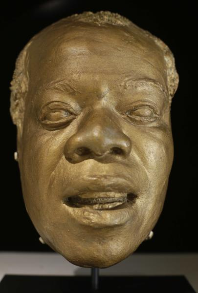 Louis Armstrong's life mask appears on display at the Louis Armstrong House Museum, Wednesday, Oct. 9, 2013, in the Queens borough of New York. To mark the 10th anniversary of the Louis Armstrong museum in the modest brick house where he lived for 28 years, curators are unveiling one of the jazz trumpeter's most unusual artifacts, on Tuesday, Oct. 15, 2013, the plaster mask that had been stored in a cupboard for decades. (AP Photo/Frank Franklin II)