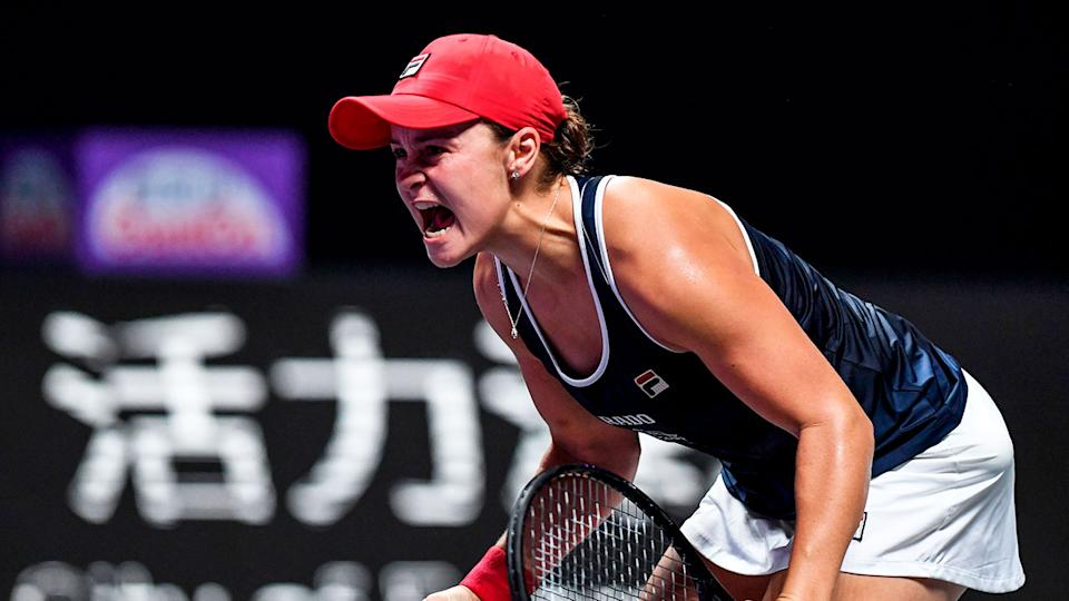 Ash Barty celebrates her win against Elina Svitolina in the WTA Finals decider.