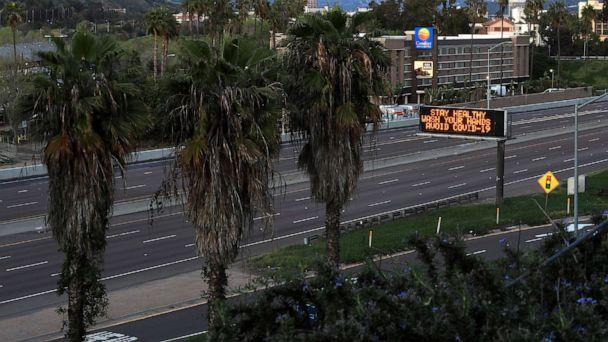PHOTO: A stretch of Interstate 8 is empty as a sign encourages hand washing on March 15, 2020 in San Diego, Calif. (Sean M. Haffey/Getty Images)