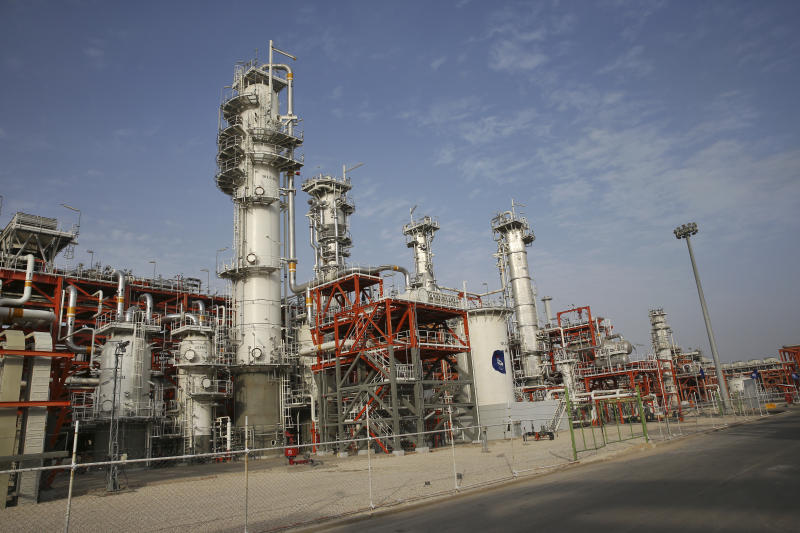 FILE - This March 16, 2019 file photo, shows a natural gas refinery at the South Pars gas field on the northern coast of the Persian Gulf, in Asaluyeh, Iran. China's state oil company has pulled out of a $5 billion deal to develop a portion of Iran's massive offshore natural gas field, the Islamic Republic's oil minister said Sunday, Oct. 6, 2019, an agreement from which France's Total SA earlier withdrew over U.S. sanctions. (AP Photo/Vahid Salemi, File)