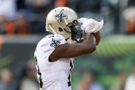 New Orleans Saints wide receiver Michael Thomas celebrates his touchdown in the first half of an NFL football game against the Cincinnati Bengals, Sunday, Nov. 11, 2018, in Cincinnati. (AP Photo/Gary Landers)