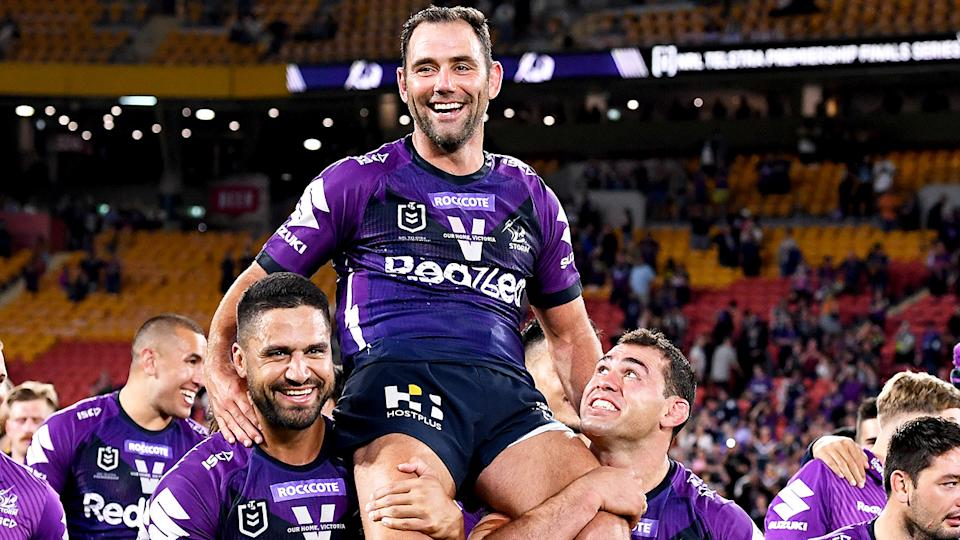 Cameron Smith is pictured being chaired off the ground after the Melbourne Storm's preliminary final win.