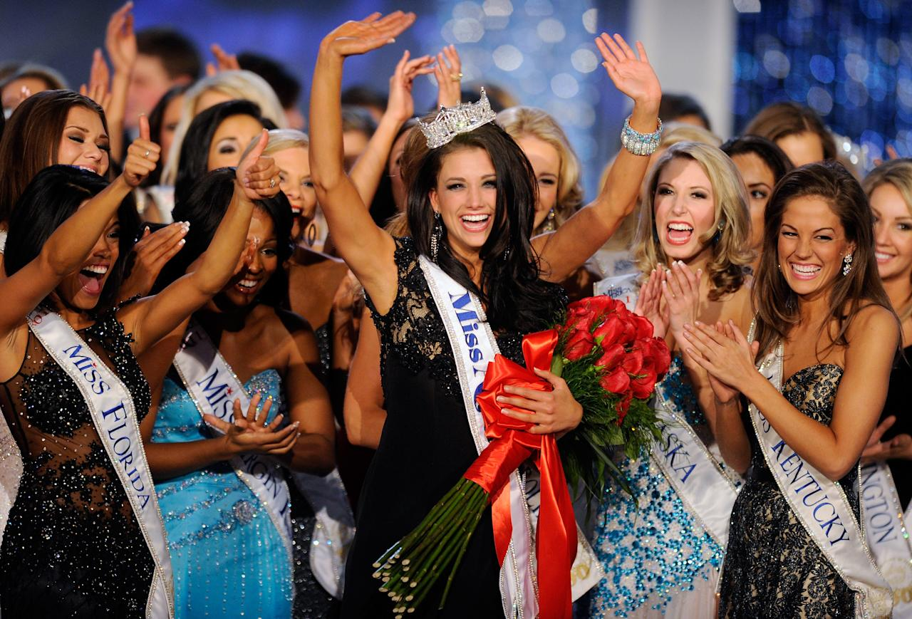 LAS VEGAS, NV - JANUARY 14:  Laura Kaeppeler (C), Miss Wisconsin, is surrounded by fellow contestants after being crowned Miss America during the 2012 Miss America Pageant at the Planet Hollywood Resort & Casino January 14, 2012 in Las Vegas, Nevada.  (Photo by Ethan Miller/Getty Images)