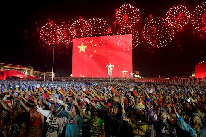 Fireworks explode over Tiananmen Square as performers take part in the evening gala marking the 70th founding anniversary of People's Republic of China, on its National Day in Beijing, China October 1, 2019. (Photo: Jason Lee/Reuters)