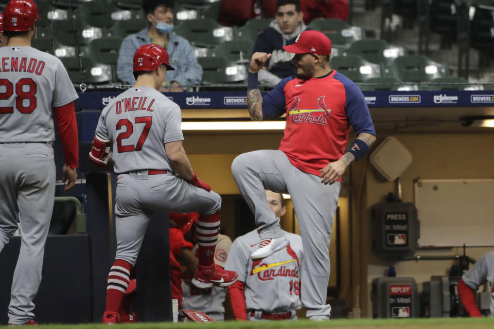 St. Louis Cardinals' Tyler O'Neill is congratulated by Yadier Molina after hitting a thre-run home run during the 11th inning of the team's baseball game against the Milwaukee Brewers on Tuesday, May 11, 2021, in Milwaukee. (AP Photo/Aaron Gash)