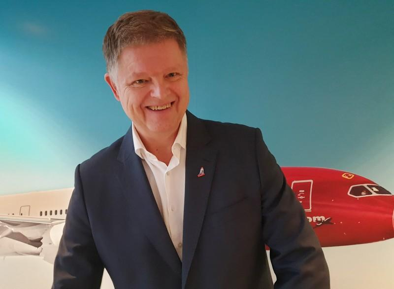 Norwegian Air CEO Schram smiles during a news conference in  Oslo