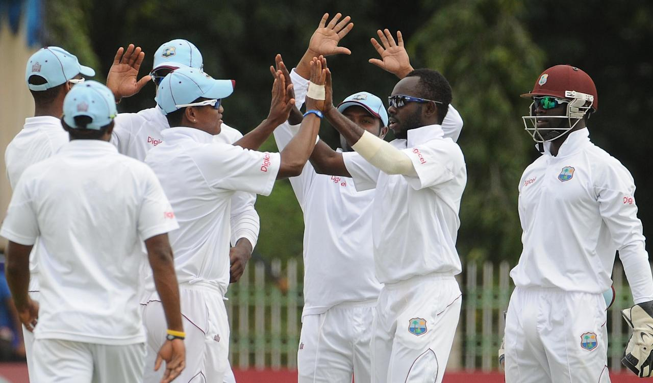 West Indies A celebrate a wicket on Day 4 of first unofficial Test between West Indies A and India A at the Gangothri Glades Cricket Ground in Mysore on Sept. 28, 2013. (Photo: IANS)