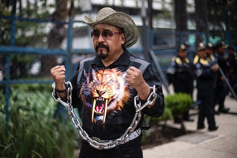 A man takes part in a protest against US immigration policies outside the US embassy in Mexico City in June 2018