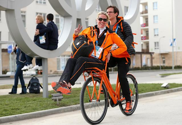 SOCHI, RUSSIA - FEBRUARY 04: Dutch Olympic personnel ride a bicycle ahead of the Sochi 2014 Winter Olympics at the Athletes Olympic Village on February 4, 2014 in Sochi, Russia. (Photo by Quinn Rooney/Getty Images)