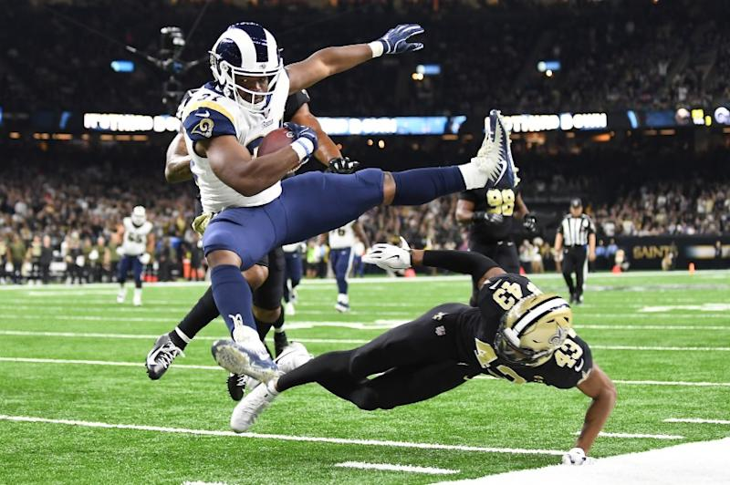 NEW ORLEANS, LOUISIANA, NOVEMBER 4, 2018-Rams running back Malcolm Brown leaps over Saints safety Marcus Williams to score a touchdown in the 3rd quarter at the Mercedes Benz Superdome in Louisiana Sunday. (Wally Skalij/Los Angeles Times)