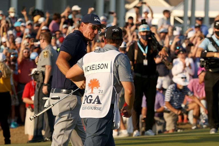 Phil Mickelson celebrates with his brother and caddie Tim Mickelson after winning the PGA Championship