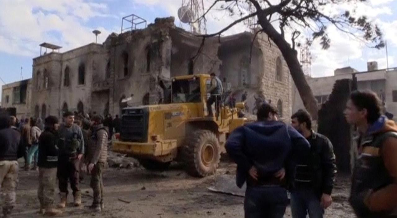 <p>A still image taken from a video obtained by Reuters shows people and a bulldozer seen outside a badly damaged building after a fuel truck blast in the centre of rebel-held Azaz, near Syria's border with Turkey, January 7, 2017. (REUTERS TV/via Reuters) </p>