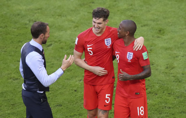 <p>England boss Gareth Southgate celebrates with England's John Stones and England's Ashley Young </p>