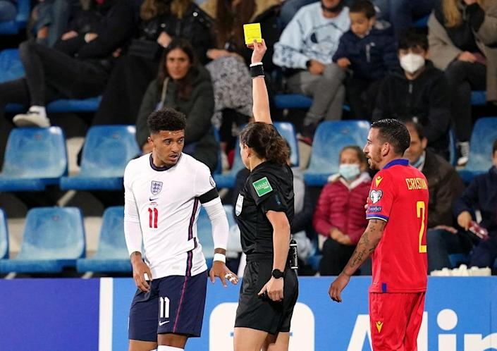 Kateryna Monzul shows a yellow card to Jadon Sancho (Nick Potts/PA) (PA Wire)