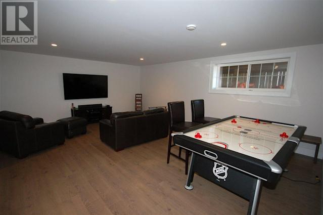 <p><span>296 Macmillan Point Road, West Covehead, P.E.I.</span><br> The spacious finished basement makes for an ideal games room.<br> (Photo: Zoocasa) </p>