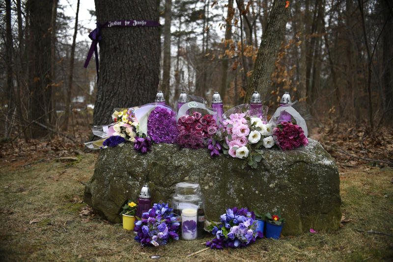 A memorial for Jennifer Dulos is seen Tuesday, Jan. 28, 2020, in Farmington, Conn. A dispatcher from the Farmington police said officers had responded to the home of Fotis Dulos, charged with murdering his estranged and missing wife, and he was later transported to the hospital  (AP Photo/Jessica Hill)