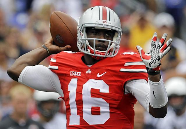 Ohio State quarterback J.T. Barrett throws to a receiver in the first half of an NCAA college football game against Navy in Baltimore, Saturday, Aug. 30, 2014. (AP Photo/Patrick Semansky)