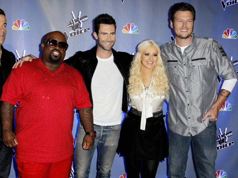 "FILE - This Oct. 28, 2011 file photo shows, from left, Carson Daly, Cee Lo Green, Adam Levine, Blake Shelton, and Christina Aguilera, from the reality television competition ""The Voice"",  in Culver City, Calif. The NBC singing contest said Friday that Christina Aguilera and Cee Lo Green would return for ""The Voice"" Season 5, joining Adam Levine and Blake Shelton. Their midseason replacements _ Shakira and Usher _ will be back for Season 6, which will air in midseason 2014. (AP Photo/Matt Sayles, file)"