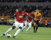 Manchester United's Paul Pogba, front, fails to score penalty shot during the English Premier League soccer match between Wolverhampton Wanderers and Manchester United at the Molineux Stadium in Wolverhampton, England, Monday, Aug. 19, 2019. (AP Photo/Rui Vieira)