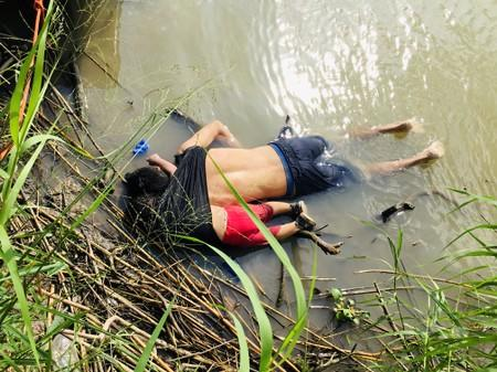 The bodies of a Salvadorian migrant and his daughter are seen at the Rio Bravo river in Matamoros