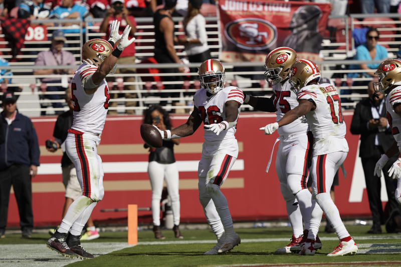 San Francisco 49ers running back Tevin Coleman celebrates and is greeted by his teammates after scoring a touchdown during the first half of an NFL football game against the Carolina Panthers in Santa Clara, Calif., Sunday, Oct. 27, 2019. The touchdown was Coleman's third in the first half. (AP Photo/Tony Avelar)