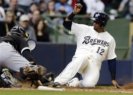 Milwaukee Brewers' Martin Maldonado (12) is tagged out at home plate by Chicago White Sox catcher Tyler Flowers, left, during the fourth inning of an exhibition baseball game, Saturday, March 30, 2013, in Milwaukee. (AP Photo/Jeffrey Phelps)