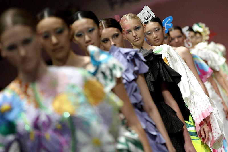 SINGAPORE - OCTOBER 13: A model showcases designs by Yoshiki Hishinuma on the catwalk on day 5 of Fashion Week 2013 at the Sands Expo & Convention Centre on October 13, 2013 in Singapore. (Photo by Suhaimi Abdullah/Getty Images)