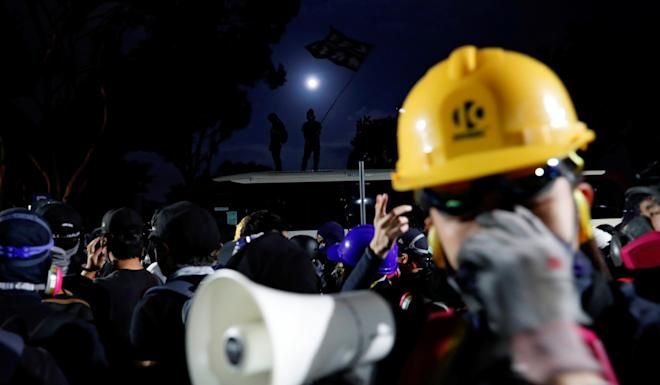 Anti-government protesters react during a stand-off with riot police at the Chinese University of Hong Kong on Tuesday night. Photo: Reuters