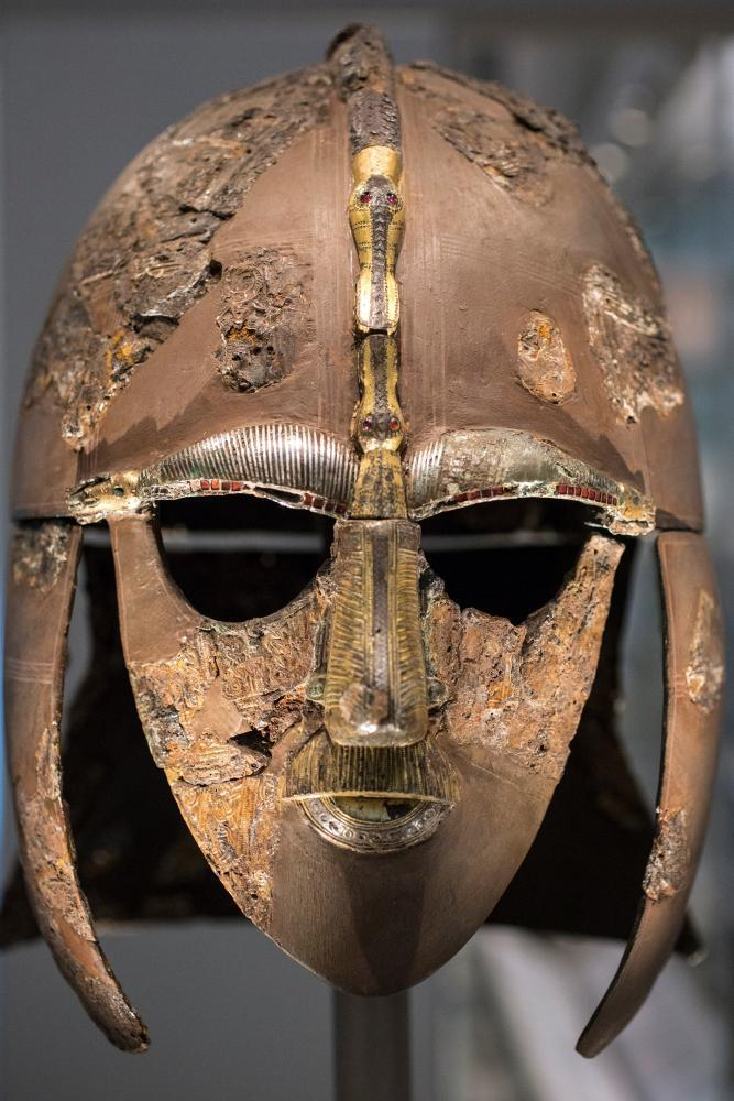 The Sutton Hoo helmet, the centrepiece of the collection, was reconstructed from fragments, and may have belonged to a king.