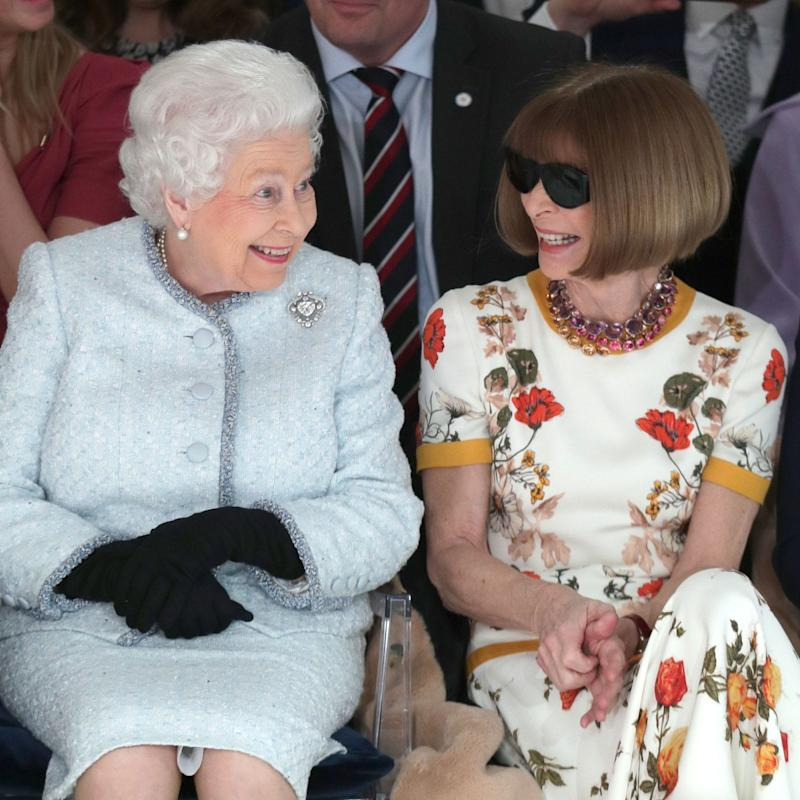 Queen Elizabeth II sits next to Anna Wintour as they view Richard Quinn's runway show at London Fashion Week earlier this week. - Getty Images Europe