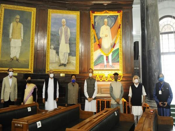 Parliamentarians including Speaker Om Birla after paying floral tributes at the portrait of Pandit Jawaharlal Nehru in the Central Hall of Parliament House on his birth anniversary. [Photo/ANI]