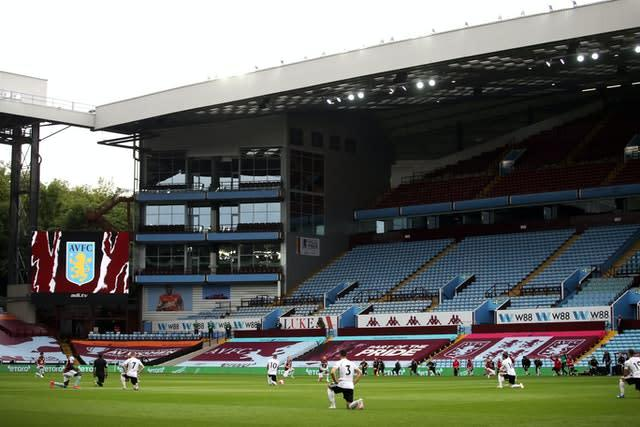 Aston Villa and Sheffield United players take a knee before kick-off in front of empty stands (Carl Recine/NMC Pool/PA)