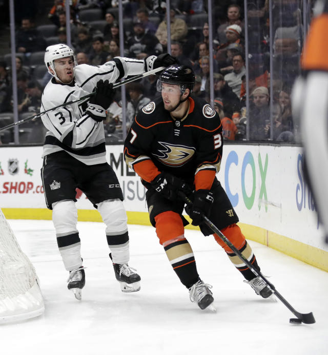 Anaheim Ducks' Nick Ritchie, right, is chased by Los Angeles Kings' Matt Roy during the second period of an NHL hockey game, Monday, Dec. 2, 2019, in Anaheim, Calif. (AP Photo/Marcio Jose Sanchez)
